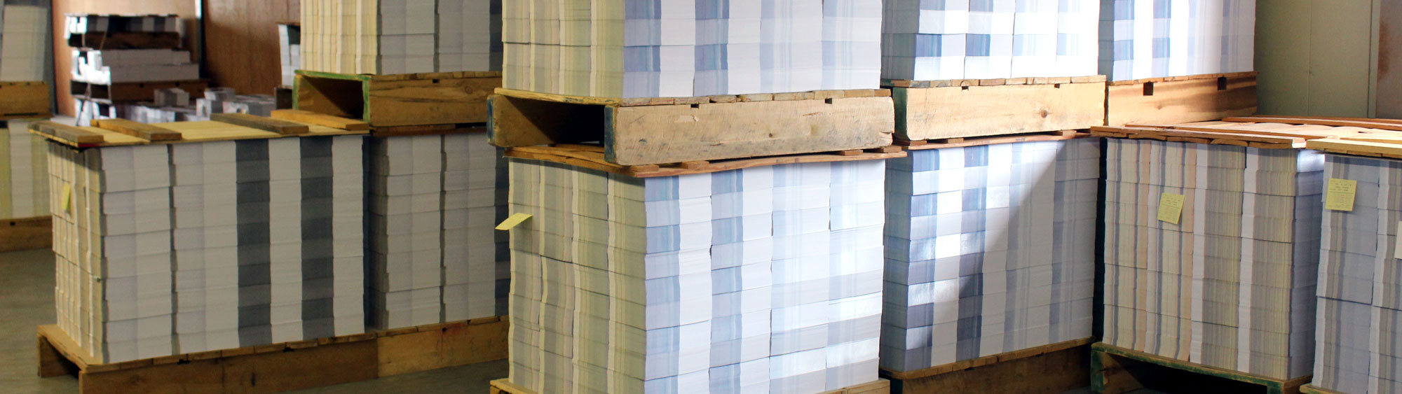 Palletized stacks of pre-printed weekly church bulletins awaiting shipment at Cathedral Press in Long Prairie, MN